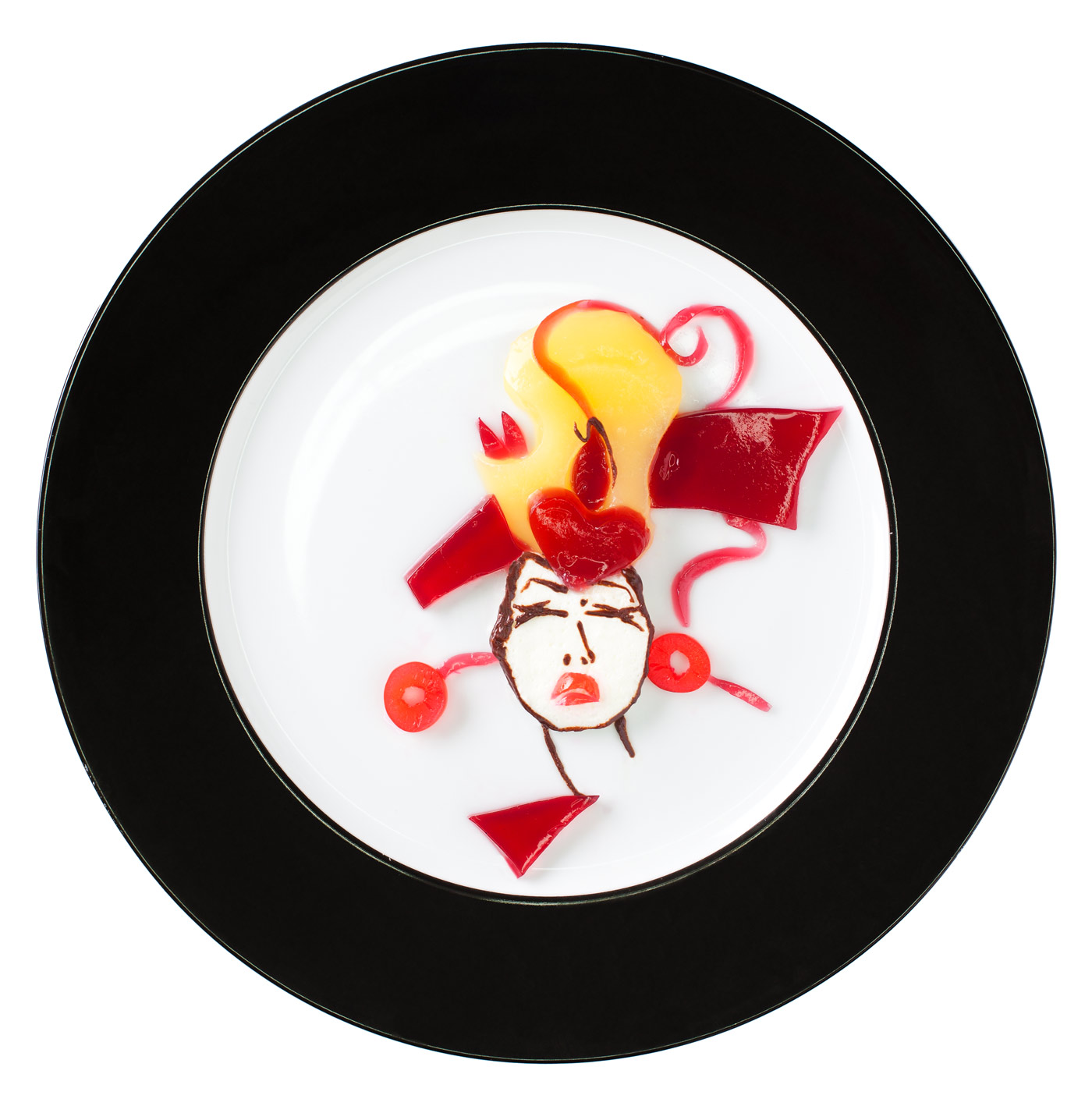 Fashion food, fruit jelly with cream depicting a womans portrait wearing earrings and a hat