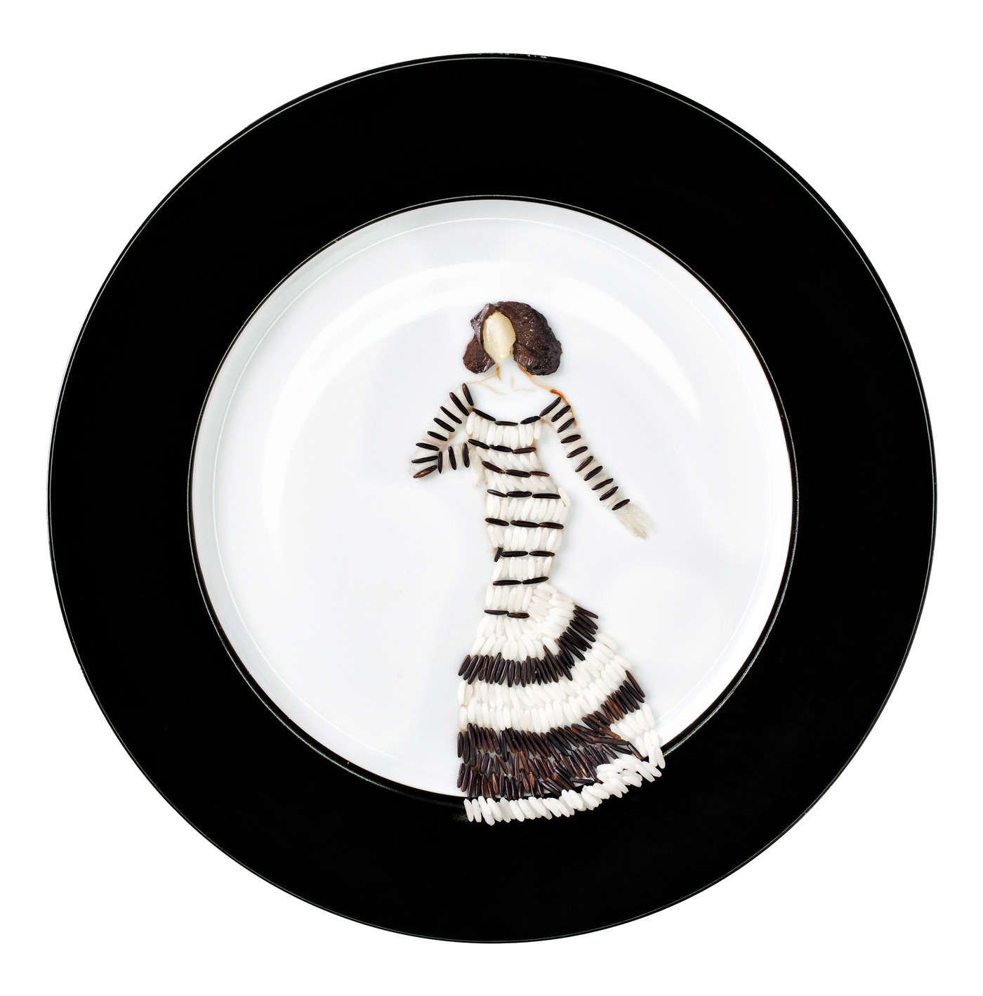 Fashion food, black and white rice with mushrooms depicting a women wearing an op art dress