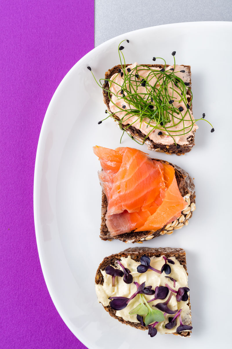 Breakfast plate with slices of bread, salmon and pate
