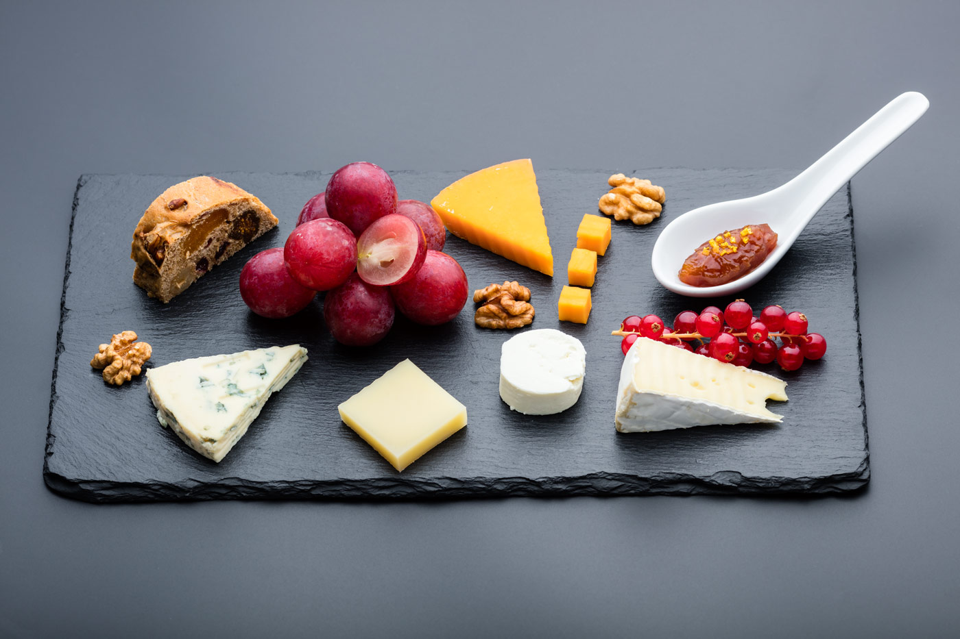 Plate with desert, cheese, grapes and bread