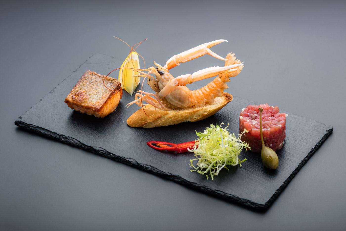 Plate with salmon, prawn and salmon tartar