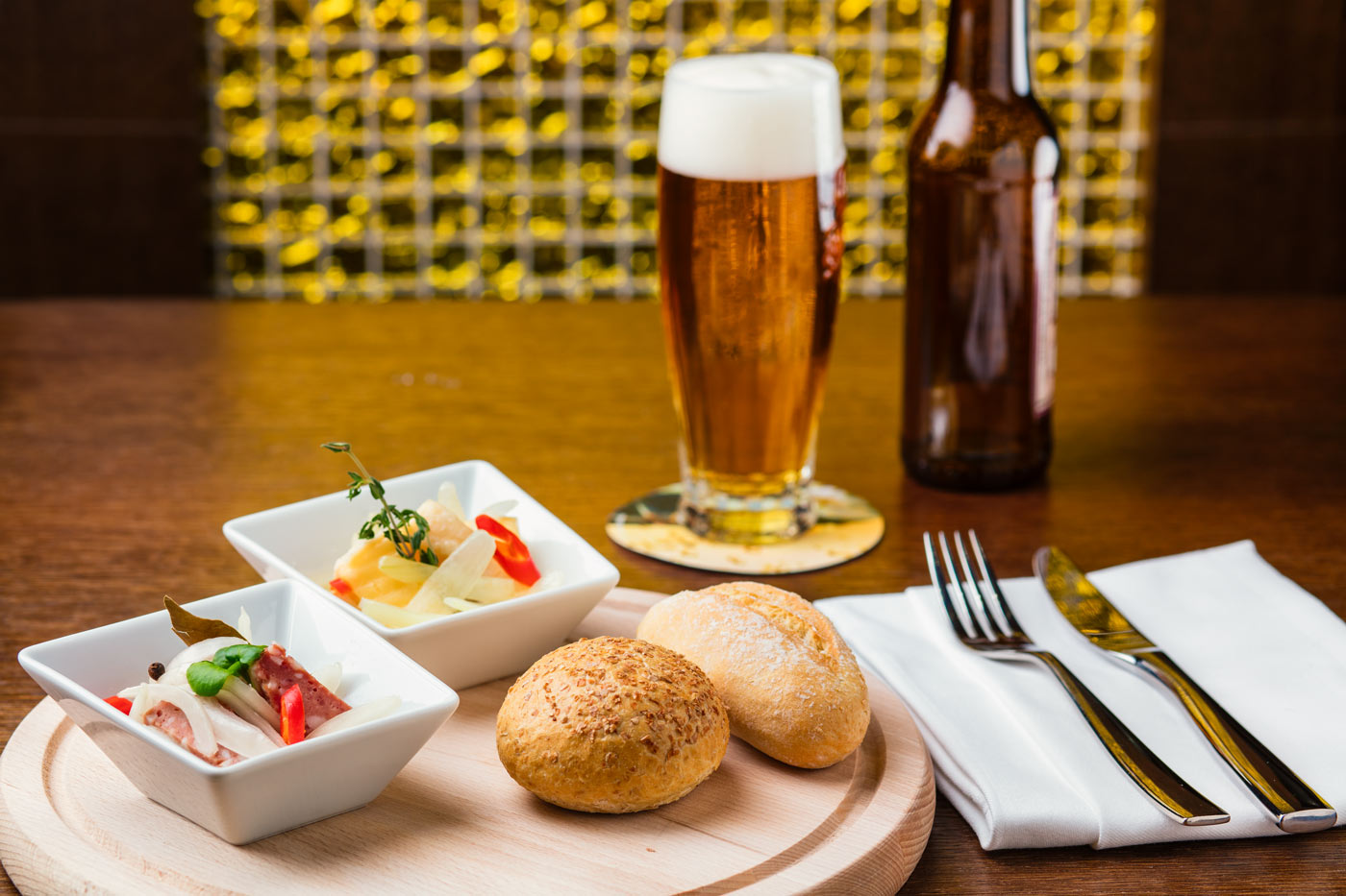 Meat and salad with bread and beer
