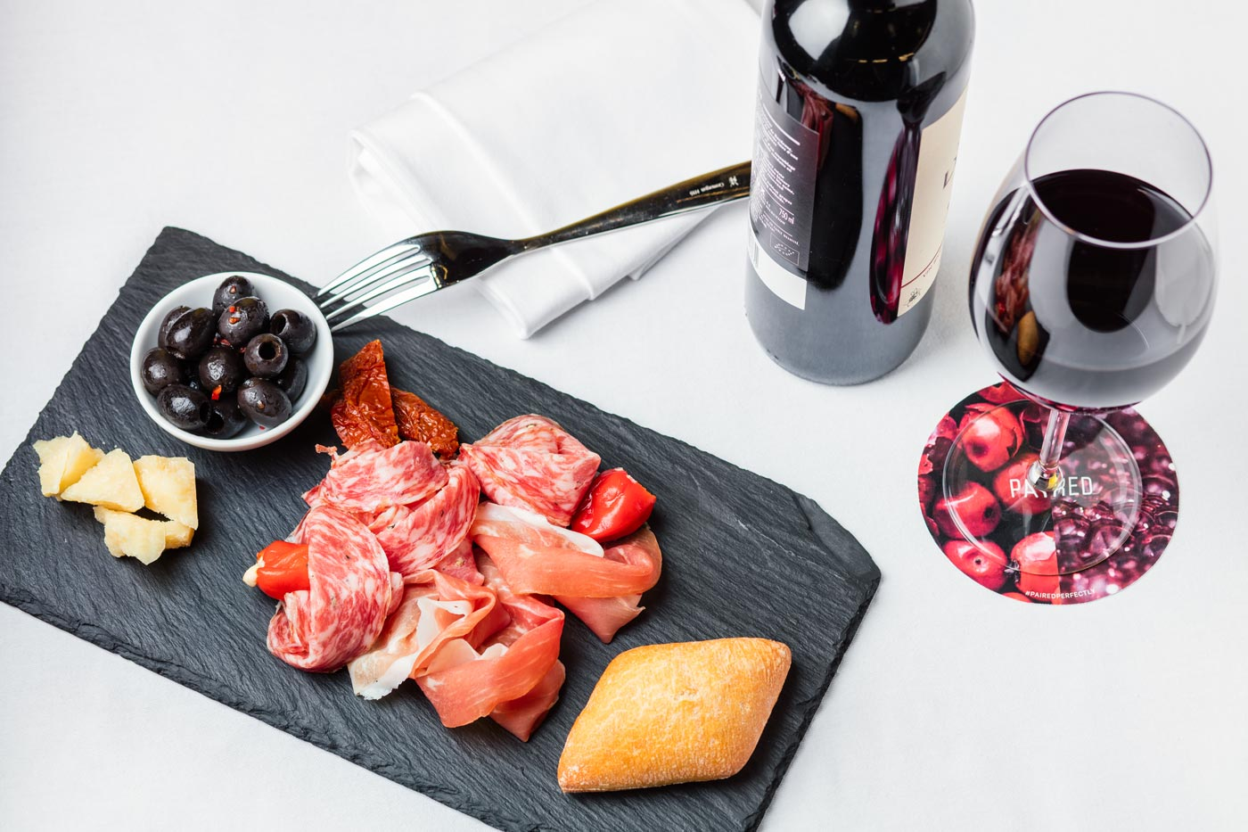 Salami and italian ham, olives, ciabatta and red wine